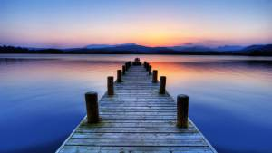 boat jetty sunset lake windermere lake district cumbria england uk europe